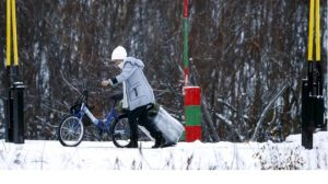 Thousands of people used bicycles to cross the Arctic border between Russia and Norway