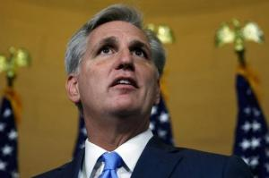 U.S. House Majority Leader Kevin McCarthy (R-CA)  explains his decision to pull out of a Republican caucus secret ballot vote to determine the nominee to replace retiring House Speaker John Boehner on Capitol Hill in Washington, October 8, 2015.  REUTERS/Jonathan Ernst