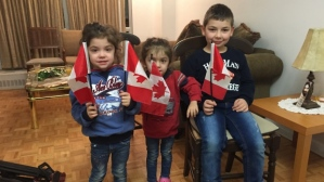 Reta, Aline and Kevork, who came to Canada with their parents, Zouvik Baghjajian and Hagop Bozyakalian, as refugees five months ago. (Laura Lynch/CBC)
