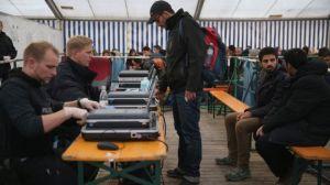Refugees registering for I.D in Germany