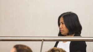 Loraine Anne Jayme stands in the dock during her appearance in the Hamilton District Court on Wednesday. Jayme, 35, is facing 284 charges relating to the obtaining work visas for immigrant Filipino dairy workers by allegedly fraudulent means.