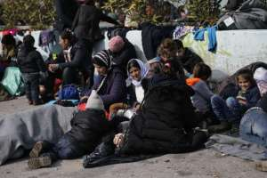 Refugees and migrants resting outside a passenger terminal at the port of Piraeus, near Athens, Greece, on Feb 8, 2016. PHOTO: REUTERS