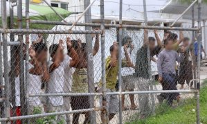 Asylum seekers at the Manus Island detention centre in Papua New Guinea. Asylum seekers who arrive in Australia by boat without a visa are sent to either Manus or Nauru, where most are held in indefinite, arbitrary detention. Photograph: Stringer/Reuters