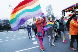 Activists form the lesbian, gay, bisexual, and transgender (LGBT) community protest against Uganda's anti-gay bill in front of the Ugandan embassy in Hellerup on the outskirts of Copenhagen, Denmark, 07 March 2014.
