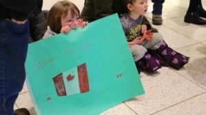 Churchgoers and members of the community showed up at the Fort McMurray airport on Tuesday night to welcome the family of Syrian refugees. (Submitted by Fort City Church)